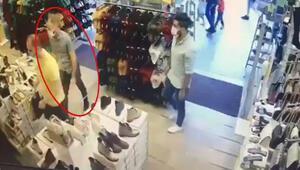İstanbulda ayakkabı mağazasında müşterinin telefonunu çalan şüpheli kamerada