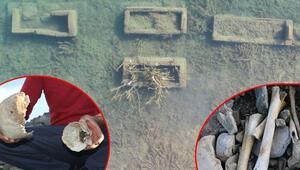 Baraj suyu altında kalan mezarlık sular çekilince ortaya çıktı