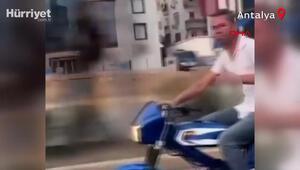 Alkol dolu bardakla motosiklet sürdü