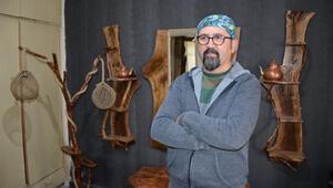 25 yıl sonra memleketine döndü, eski ahşapları sanata dönüştürüyor