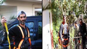 Dış cephe boyası yaparken iskelede mahsur kalan işçileri vatandaşlar kurtardı