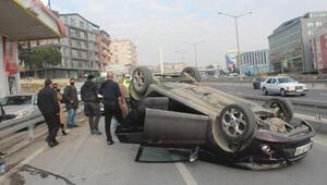 Takla atan otomobilin sürücüsü, yara almadan kurtuldu