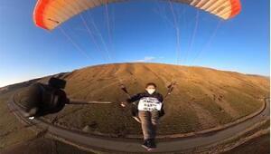 Yamaç paraşütüyle 1900 metrede koronavirüs uyarısı