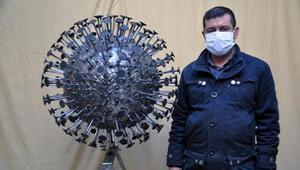 Koronavirüsün heykelini yaptı
