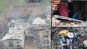 Araklıda 7 evin yandığı yangının ardından aileler, enkazda eşyalarını aradı