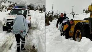 Kolu yanan çocuğu, karla kapalı yolda sırtta taşıdılar