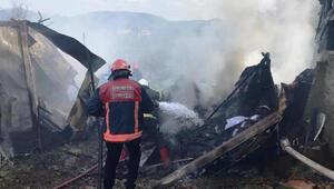 Çamaşır makinesinden çıkan yangında konteyner yandı