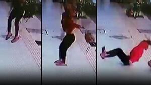 Bir kadının balkondan düşüp yaralanma anı güvenlik kamerasına yansıdı