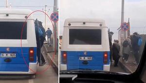 Trafikte tepki çeken görüntü Yolcular dışarı taşar halde yolculuk etti
