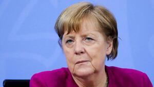 Merkel katı kısıtlamalarda ısrarlı