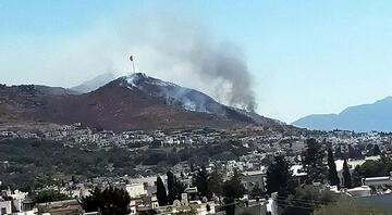Bodrumda yerleşim yerleri yakınında yangın