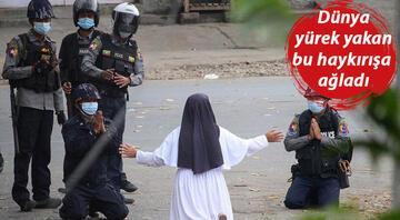 Dünyanın konuştuğu fotoğraf: Rahibe diz çöküp polislere böyle yalvardı
