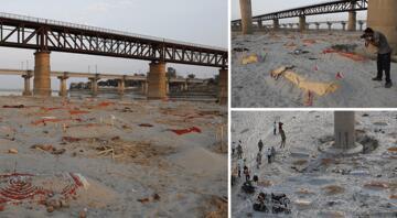 Yağmur yüzlerce cesedi ortaya çıkardı