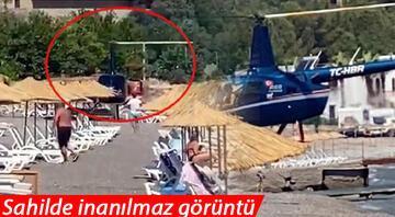 Muğlanın Marmaris ilçesinde tepki çeken görüntü Helikopter sahile indi