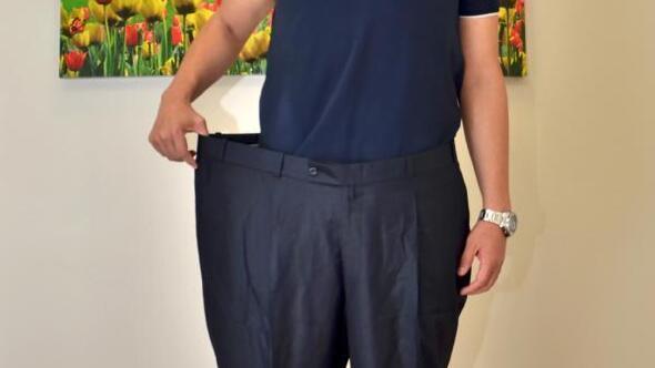 Kilolu günlerini unutmamak için 64 beden pantolonunu çerçeveletecek