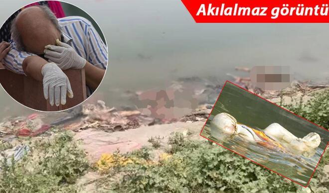Hindistan'dan inanılmaz görüntü! Cesetler nehir kıyısına vurdu