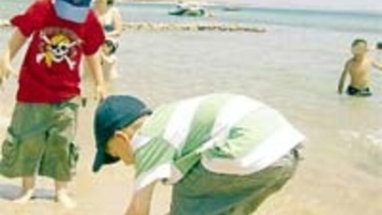 Plaj hırsızlarını fotoğraf ele verdi