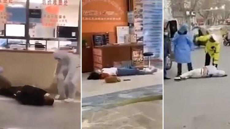 Son dakika haberi: Çin sokaklarında virüsten etkilenenlerin yere yığıldığı videolar ortaya çıktı