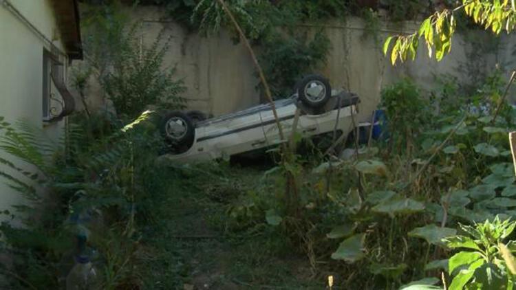 Sarıyer'de otomobil 15 metre yükseklikten evin bahçesine düştü