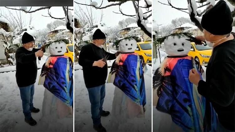 Berber, yaptığı kardan adamı tıraş etti