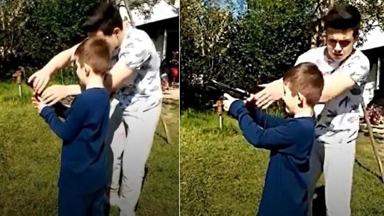 Tepki çeken görüntü Dayısı tabancayla ateş ettirdi, babası çekti