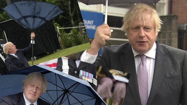 Dünya bu anları konuşuyor: İngiltere yağmura, Boris Johnson şemsiyesine teslim oldu