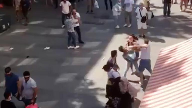 Fight with kicks and blows on the busiest street in Antalya.  They fell to the ground and jumped on him