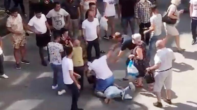 Kick and slap on the busiest street in Antalya.  They fell to the ground and jumped on him