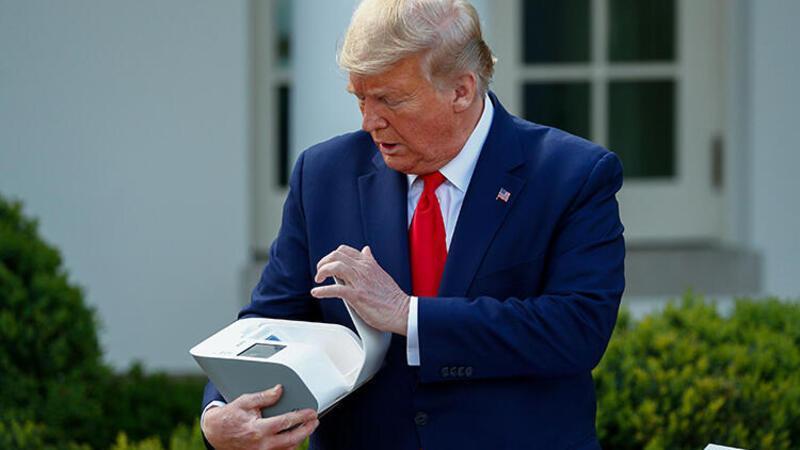 Trump, N95 maskesini dezenfekte eden cihazı tanıttı