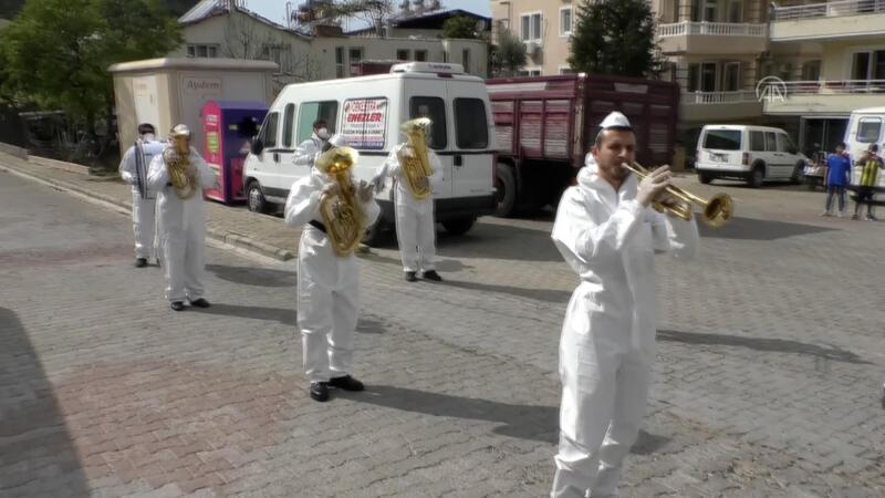Marching bands perform on streets to boost locals' morale
