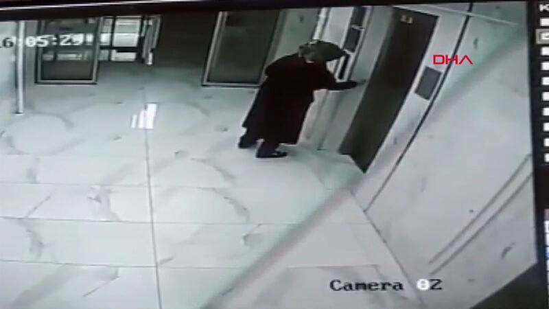 Şüpheli maddeyi binanın içine süren ve kameralara yakalanan kadın panik yarattı