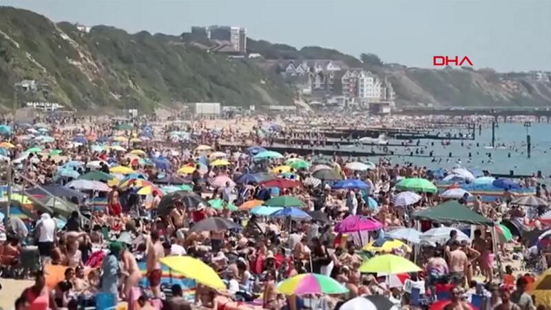 İngiltere'de güneşi gören plajlara akın ediyor