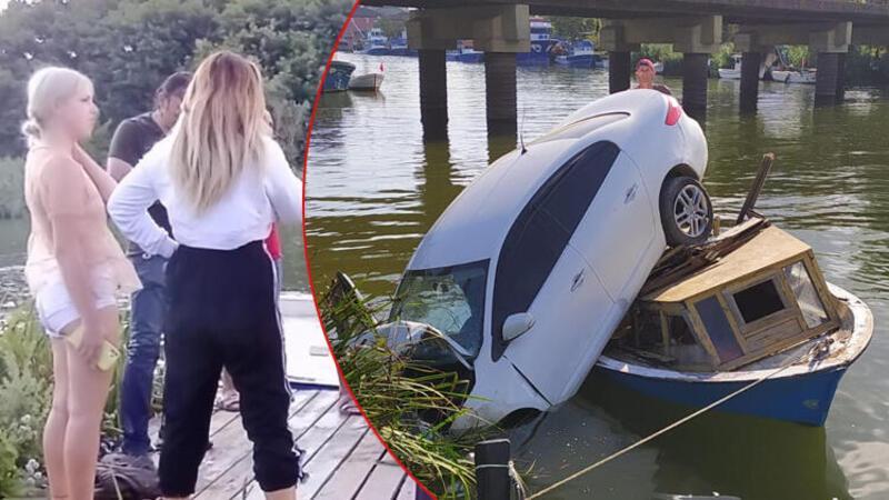 Otomobil nehir kenarındaki teknenin üzerine çıktı