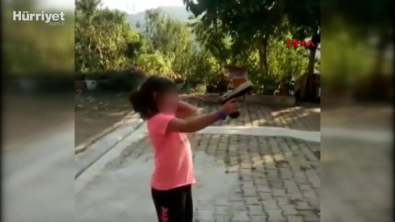 Küçük kıza zorla ateş ettirdi, vurulma tehlikesi atlattı